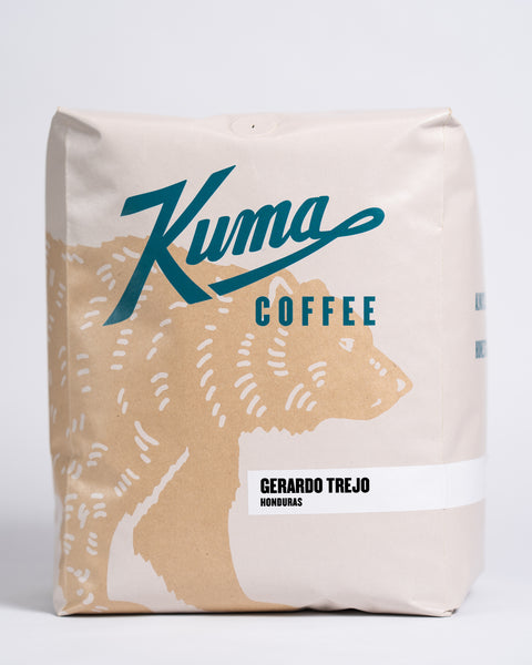 5 lb bag of Kuma Coffee, kraft brown bear with teal logo, the coffee name Gerardo Trejo and Honduras written in the lower right corner