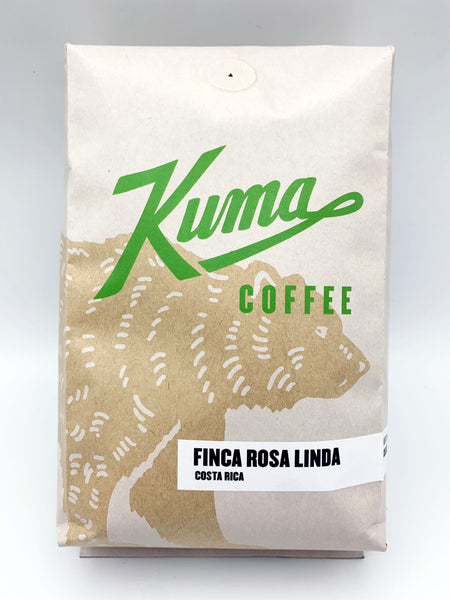 A craft bag of bulk coffee with a green logo and a Limited Edition sticker, with the text Finca Rosa Linda Costa Rica from Kuma Coffee