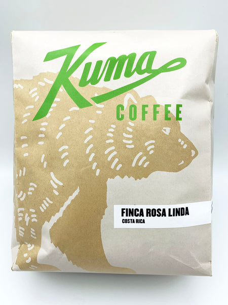 A kraft bulk bag of coffee with a green logo, with the text Finca Rosa Linda Costa Rica from Kuma Coffee