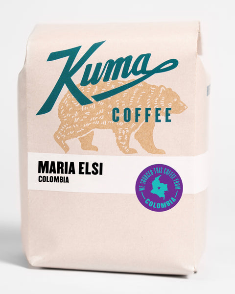 A 12oz bag of Kuma Coffee, kraft brown bear with teal logo, the coffee named Maria Elsi, washed coffee from Colombia
