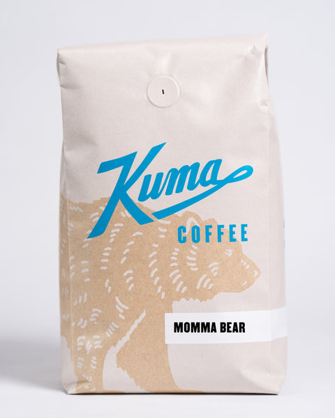 2.5 lb bag of Kuma Coffee, kraft brown bear with blue logo, the coffee name Momma Bear written in the lower right corner