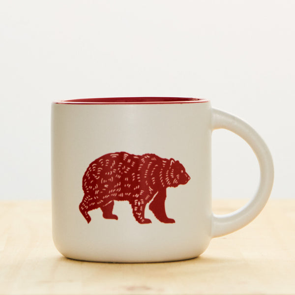 14 oz white stoneware coffee mug with Kuma Coffee bear logo in red