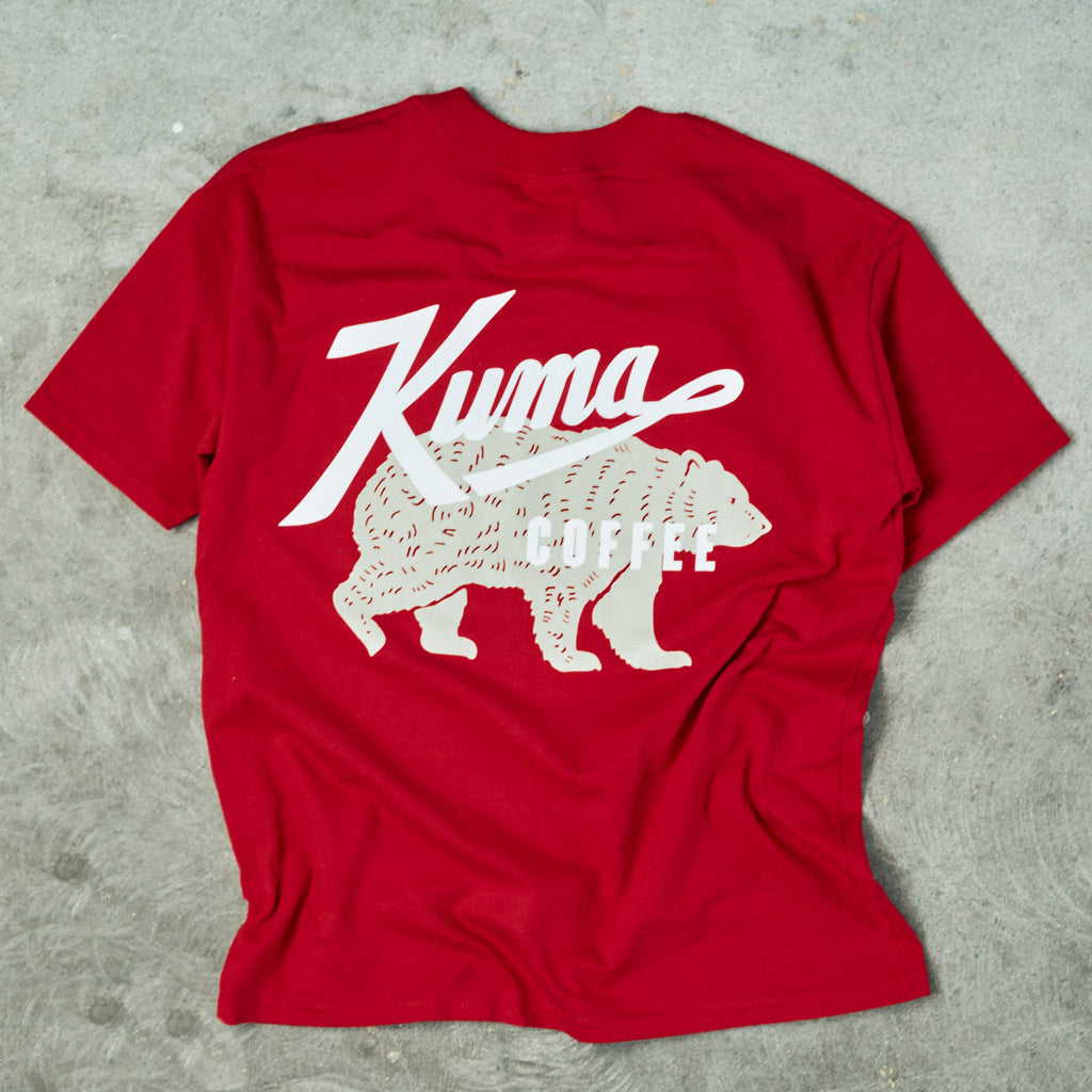 Red T Shirt with white kuma coffee logo and grey kuma bear mascot behind it