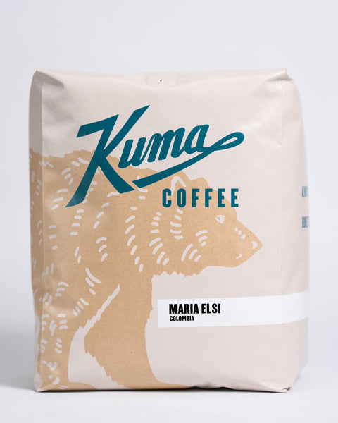 5 lb bag of Kuma Coffee, kraft brown bear with teal logo, the coffee name Maria Elsi and Colombia written in the lower right corner