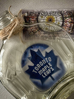 SLUMPED GLASS BOTTLE WITH HOCKEY LOGO
