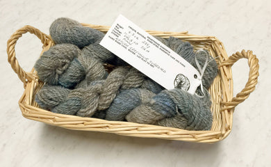 Hand spun natural gray and overdyed Finn yarn