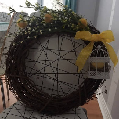 Spring Wreath with Birdcage and Yellow Ribbon