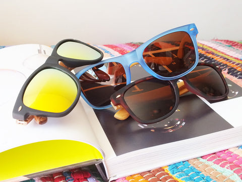 Group of sunglasses in different colour combinations, all with wooden arms