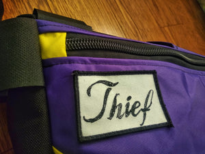 Thief bikepacking frame bag in purple and yellow.