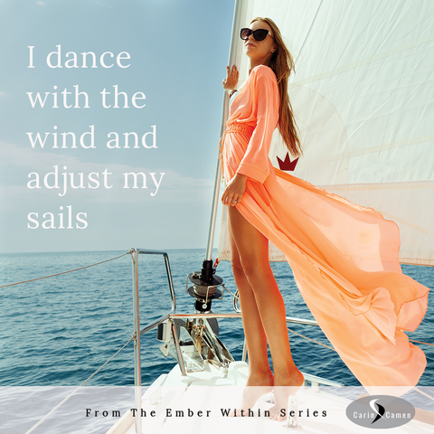 Woman holding onto sail with wind blowing her dress.