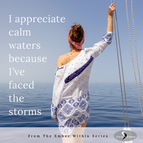 Woman holding onto the sail rope looking out on calm waters.