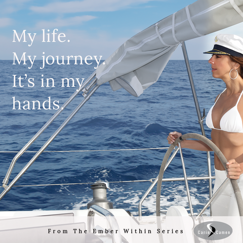 Woman standing and holding the boat wheel as she steers the boat across the sea.