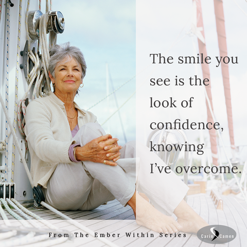 Woman sitting on boat in a reflective smile.