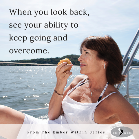 Woman relaxing on boat eating a peach and looking reflective.
