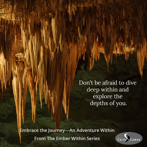 Cave with orange colored stalactites against a dark background.