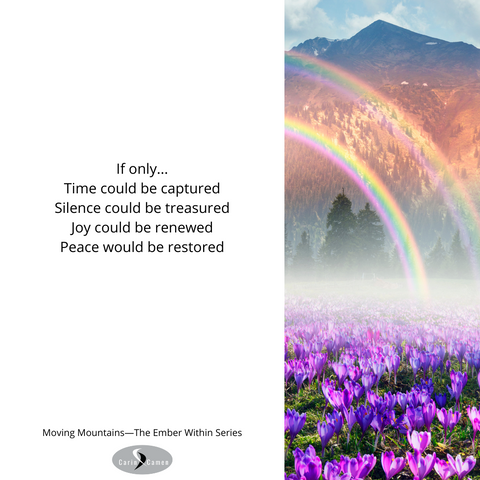 Rainbow over field of flowers with mountain backdrop.