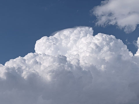 Billowing clouds against a beautiful blue sky.