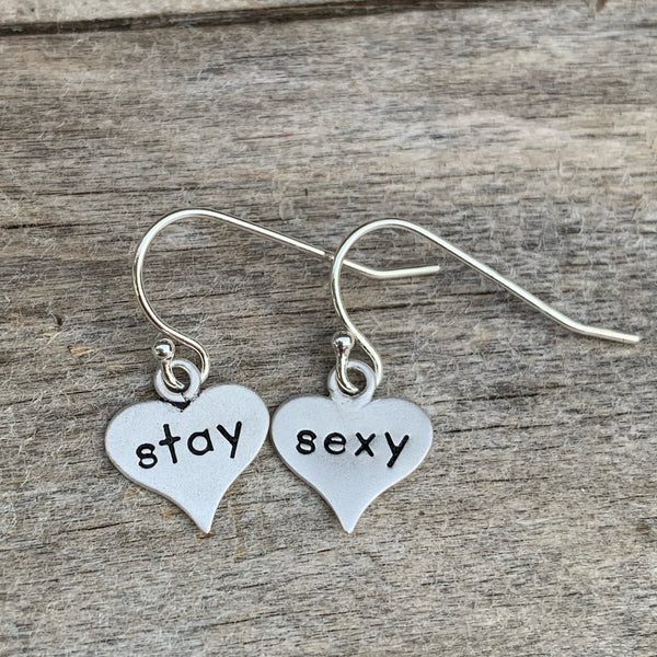 "Pair of sterling silver earrings - heart shaped - ""stay sexy"""