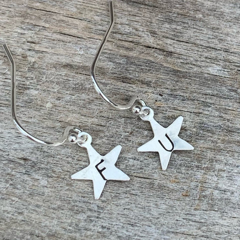 "Pair of tiny sterling silver earrings - star shape - "" F U"""