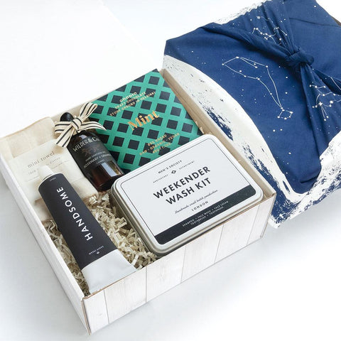 KADOO Dapper Man gift box with galaxy space special edition cotton bandana in navy moon. Father's Day or Gift for him. Content Goodio Mint Chocolate, Men's Society Weekender Wash Kit, Handsome Shave cream, Nawrap organic Face Towel Wilder & Co hand sanitizer.