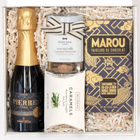 KADOO The Cheers gift box. For him, graduation, celebration and special occasion. Contains Perle Zero Blanc sparkling wine, Marou dark chocolate, Black Bow Sweets rosemary truffle almonds and McCrea's Rosemary Truffle Sea Salt caramels.