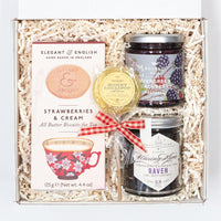KADOO Thinking of You Care Package Gift featuring Elegant & English Strawberries & Cream Cookies, Regalis Evergreen Blackberry Jam, Waxing Kara Earl Grey Tea and Honey Lollipops.