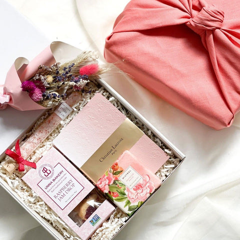 KADOO The Peony Valentine Gift box for her. Wrapped in eco-friendly Furoshiki linen. Contains: Raspberry Cookie, Christian LaCroix blush journal, Mistral soap & Bath Salt.