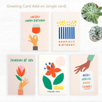 Choose greeting cards add-on by Graphic Factory. One card. Choice: Cheers! Happy Birthday. Happiest Birthday Cake, Thinking of You, Thank You, Merci, Gracias, Danke and Thanks. sourced from FSC Sustainable Forests.