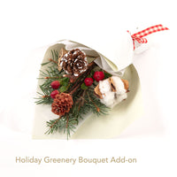 Holiday bouquet arrangement of greenery, cotton, pinecones, and red berries. Perfect add-on to elevate and brighten any gifts.