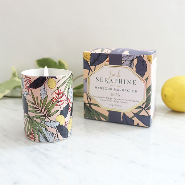 L'or de Seraphine Mansour Marrakech Candle is infused with essential oils and using 100% organic cotton wick in patterned ceramic containers. Featuring notes of bergamot, ginger dusted citrus, and touches of apple, juniper and clove. One jar, 25 hours burn time.