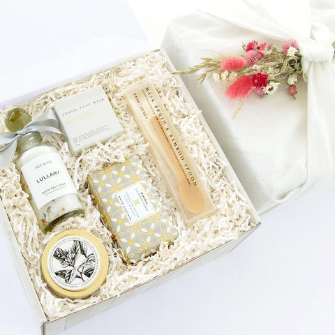 KADOO Rejuvenate Spa Gift for her gift box in Furoshiki French linen wrapping style with a bouquet of dried flowers. Contains Bath salt, clay mask, set of hair brush and wooden spoon for mask, scented candle and luxury soap.
