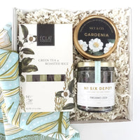 KADOO Mother's Day Tea Gardenia gift box with bandana wrap. Contains pomegranate green tea, chocolate and a scented travel candle. Perfect for moment of serenity.