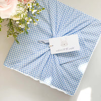 kadoo baby gifts for newborn boy. Wrapped in sustainable Furoshiki cotton wrap.