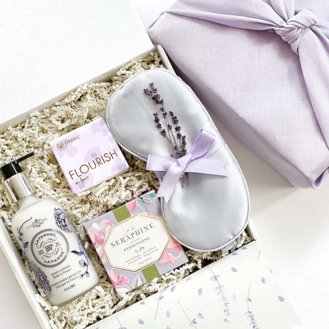 Lavender Bliss Spa Curated Gift box:  Lavender hand lotion, sustainable candle, soap, aromatherapy eye pillow or silk eye mask.