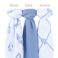 elys & co baby swaddle blue in boats pattern, solid blue and anchor pattern. 100% cotton muslin. breathable and soft. promotes healthy sleep.