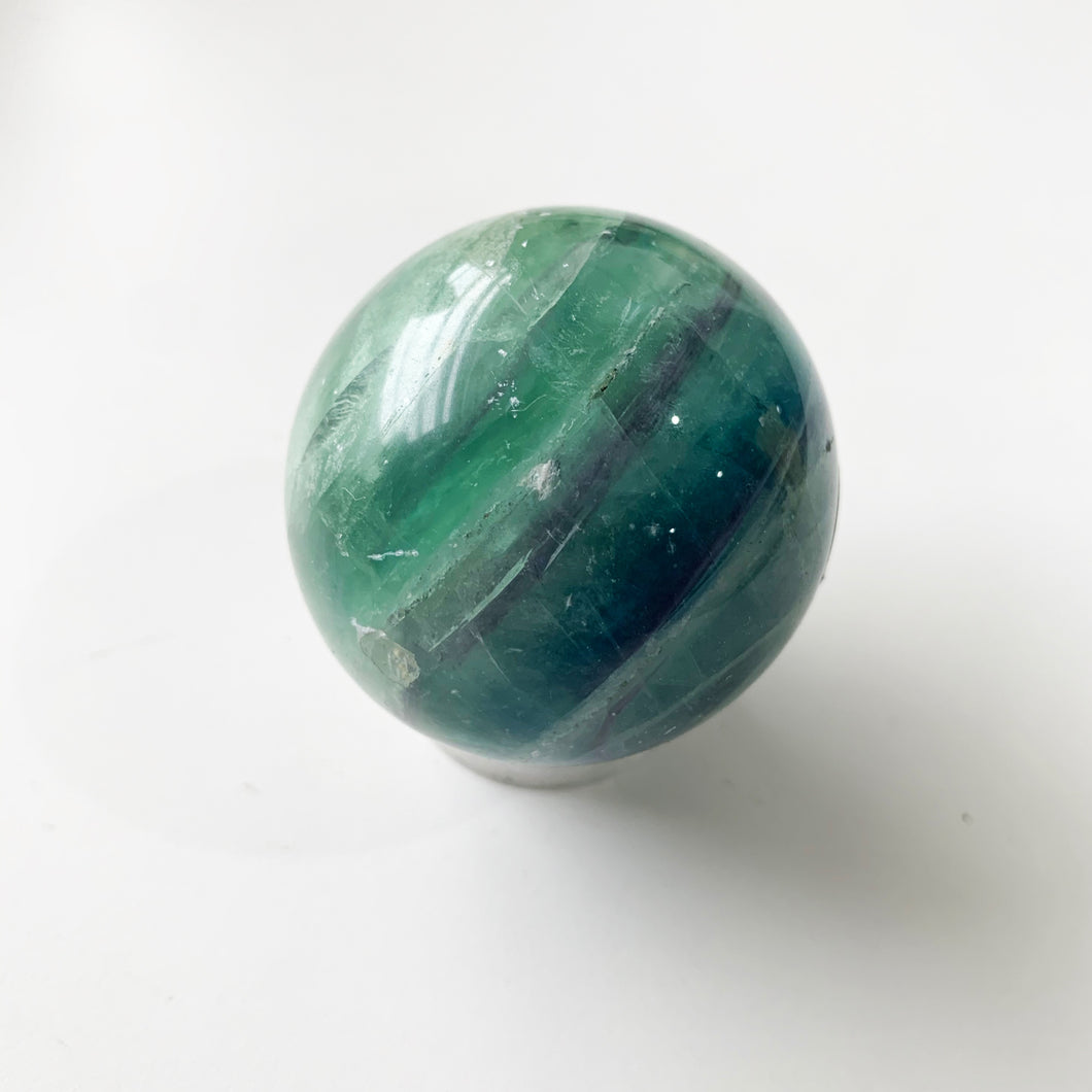 "Known as the ""Genius Stone,"" Fluorite represents the highest state of mental achievement, boosting aptitude and discernment, the absorption of new information, and helping one work through complex issues."