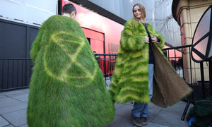 Extinction Rebellion Protesters Outside London Fashion Week Wearing Coats Made Of Grass
