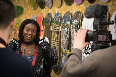 Circle Collective trainee speaks infront of camera in the social enterprise shop