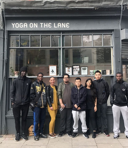 photo of Circle trainees standing in front of the yoga studio