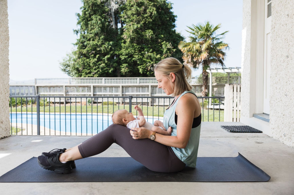 breastfeeding-mum-exercising-with-baby