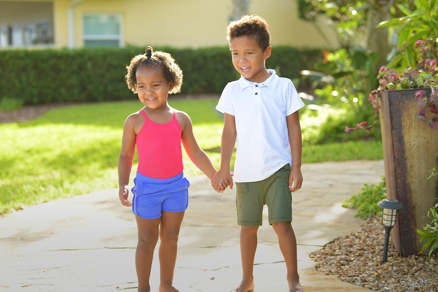 Girl and boy toddler holding hands