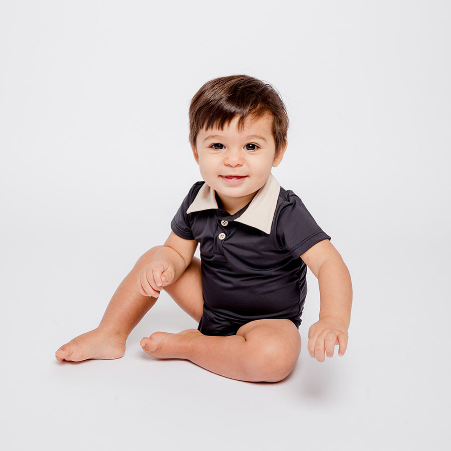 Boy in Happy Lil' One Charcoal Bodysuit