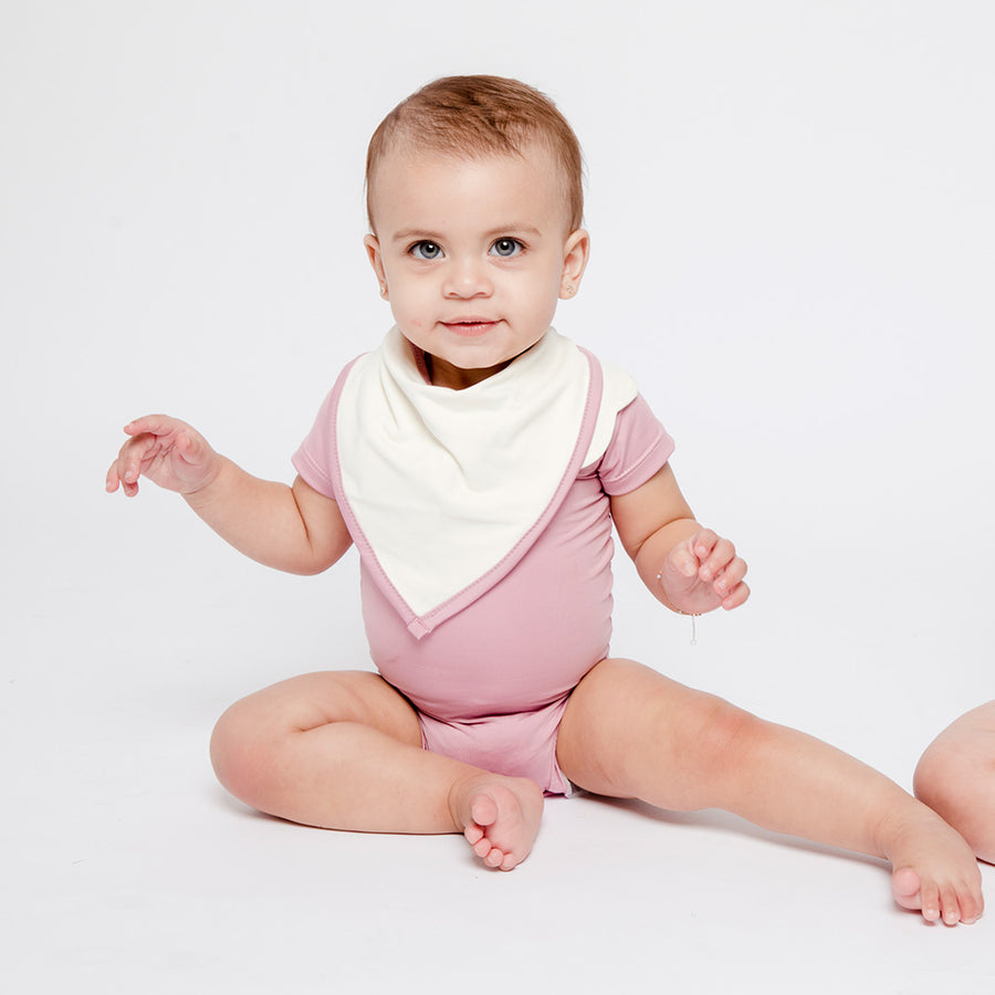 Baby Girl in Happy Lil' One Rose Pink Bodysuit and Bib