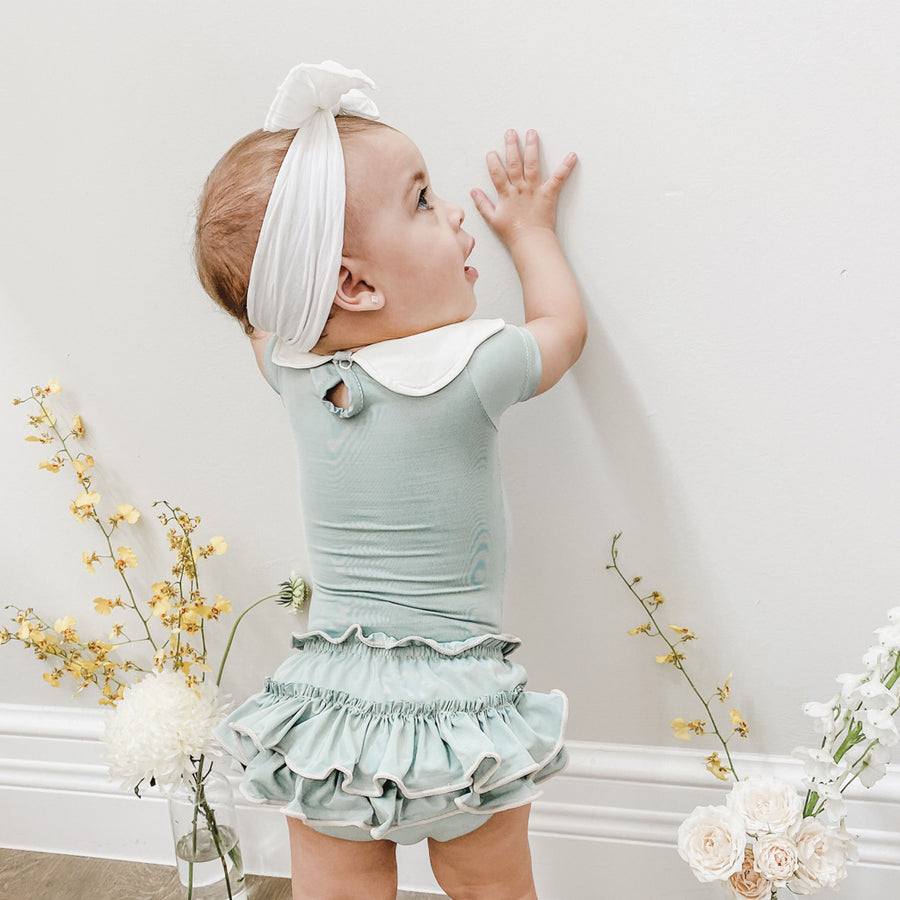 Baby Girl in Happy Lil' One Sage Green Bodysuit and Bloomer