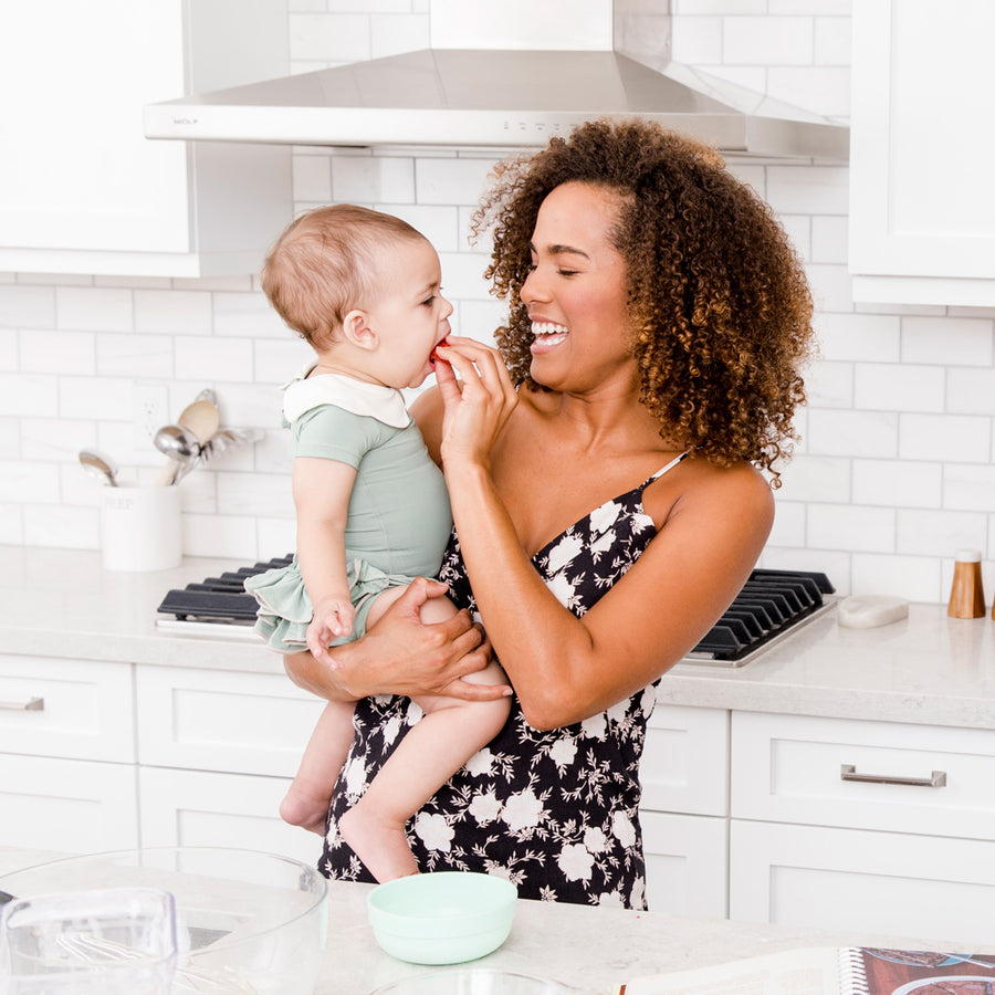 Mom in Kitchen with Baby Girl in Happy Lil' One Sage Green Bodysuit and Bloomer