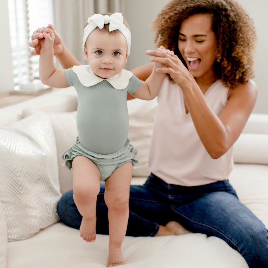 Mom with Baby Girl in Happy Lil' One Sage Green Bodysuit and Bloomer
