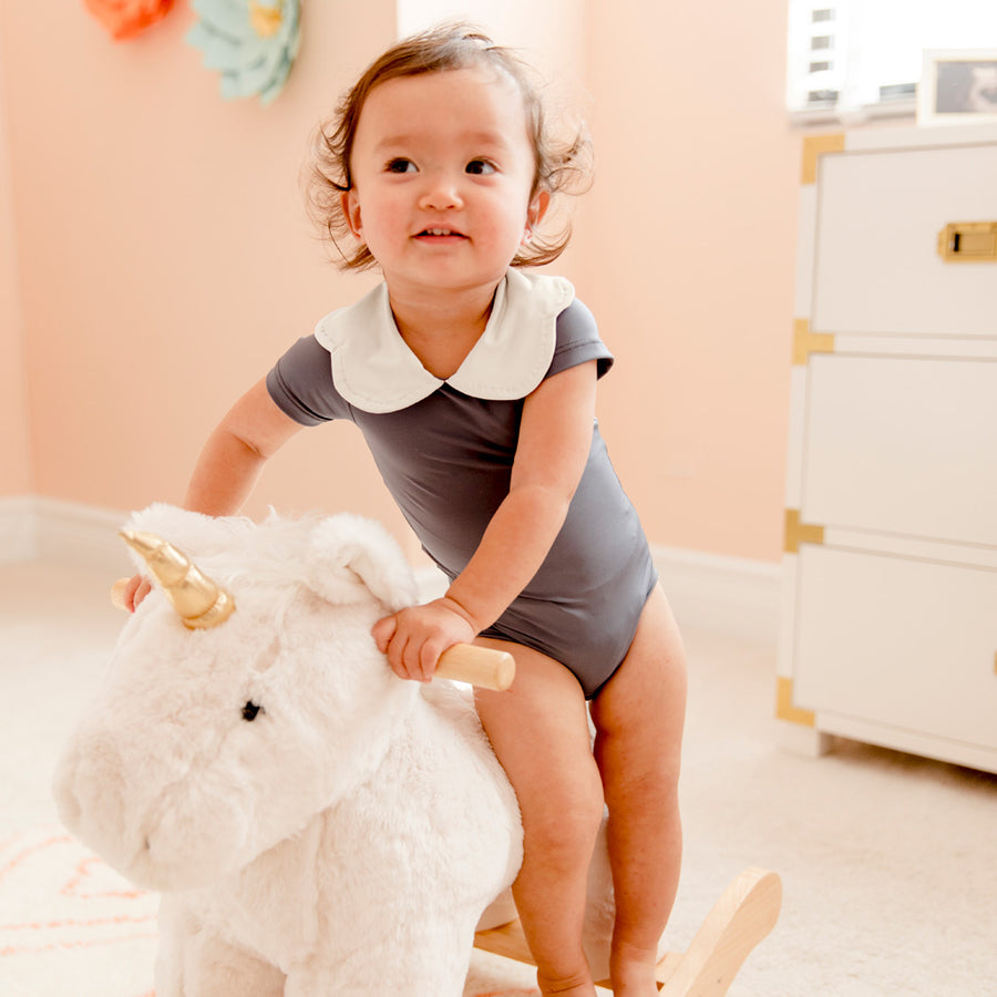 Baby Girl in Happy Lil' One Slate Blue Bodysuit