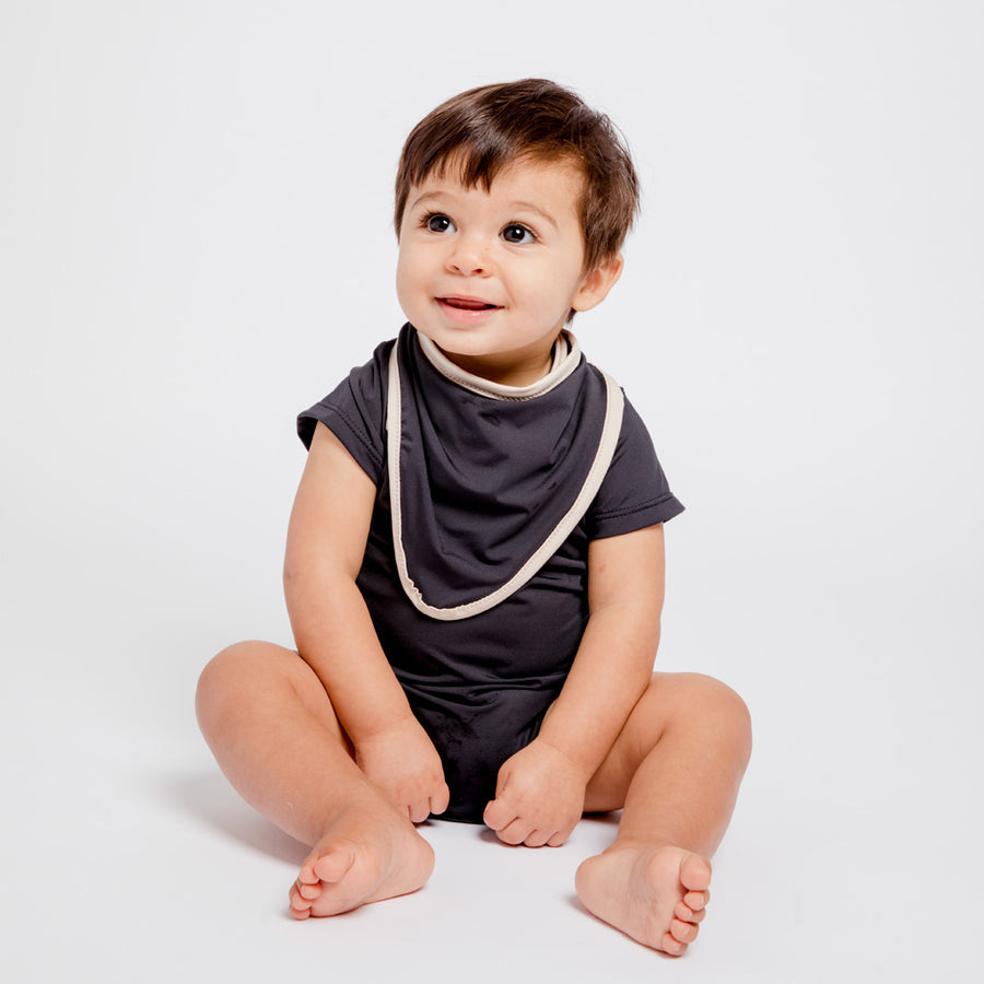 Boy in Happy Lil' One Charcoal Bodysuit and Bib