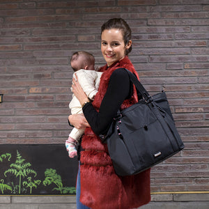 model wearing Cleo Black Baby Changing Bag | Shoulder Bag Changing Bag | Storksak – Award-winning Baby Changing Bags & Accessories