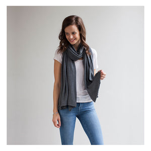 model wearing Mothers Cocoon Charcoal Breastfeeding Shawl as scarf | Multi-use nursing shawl | Storksak – Award-winning Baby Changing Bags & Accessories